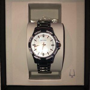 Stainless steel bracelet watch with a diamond acc